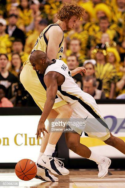 Luke Schenscher of the Georgia Tech Yellow Jackets gets in the way of Chris Paul of the Wake Forest Demon Deacons during their game on March 2 2005...