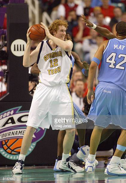 Luke Schenscher of the Georgia Tech Yellow Jackets looks to pass the ball against the University of North Carolina Tar Heels in the ACC Quarterfinal...