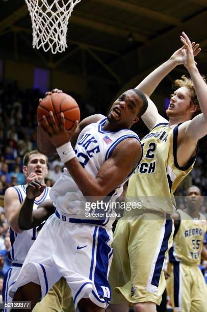 Luke Schenscher of the Georgia Tech Yellow Jackets watches as Shelden Williams of the Duke Blue Devils grabs a rebound during their game on February...