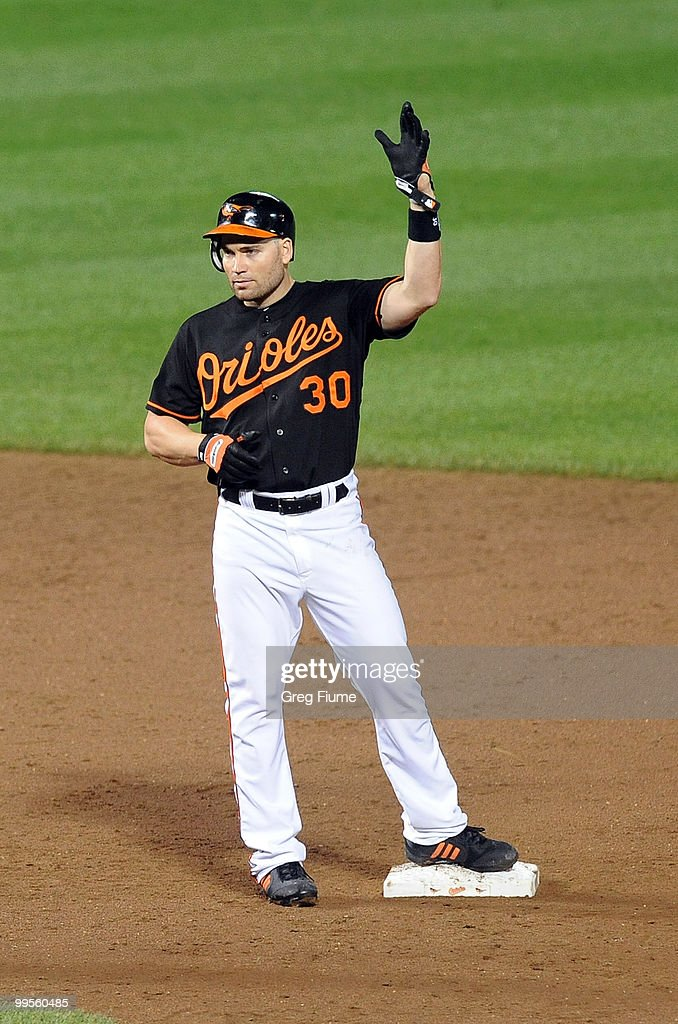 Luke Scott #30 of the Baltimore Orioles celebrates after a hit in the sixth inning against the Cleveland Indians at Camden Yards on May 14, 2010 in Baltimore, Maryland.