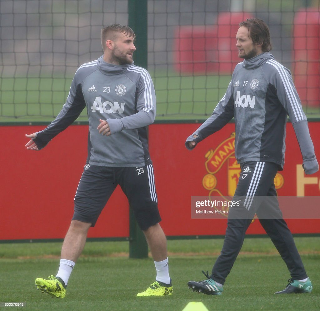 Luke Shaw and Daley Blind of Manchester United in action during a first team training session at Aon Training Complex on September 21, 2017 in Manchester, England.