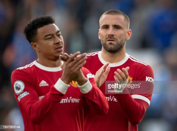 Luke Shaw and Jesse Lingard of Manchester United applaud the fans after the Premier League match between Leicester City and Manchester United at The...
