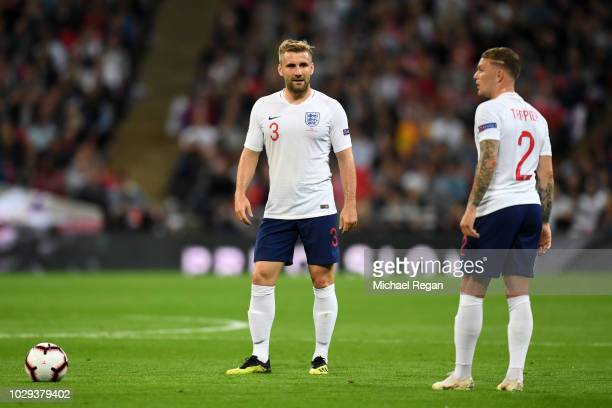 Luke Shaw and Kieran Trippier of England speak ahead of a free kick during the UEFA Nations League A group four match between England and Spain at...