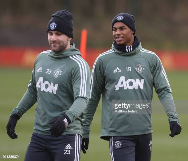 Luke Shaw and Marcus Rashford of Manchester United in action during a first team training session at Aon Training Complex on January 28 2018 in...