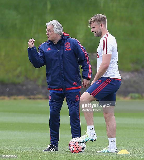 Luke Shaw and opposition coach Marcel Bout of Manchester United in action during a training session ahead of the FA Cup Final match between Crystal...