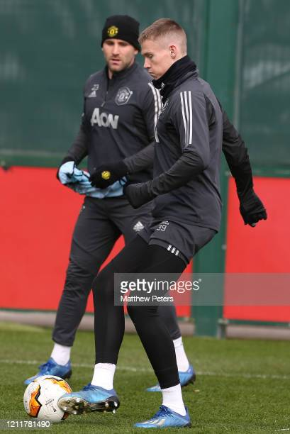 Luke Shaw and Scott McTominay of Manchester United in action during a first team training session at Aon Training Complex on March 11 2020 in...