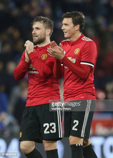 Luke Shaw and Victor Lindelof of Manchester United applaud the fans after the Emirates FA Cup Fifth Round match between Huddersfield Town and...