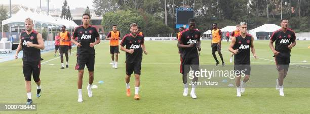 Luke Shaw Chris Smalling Juan Mata Eric Bailly Andreas Pereira and Anthony Martial of Manchester United take part in a first team training session as...