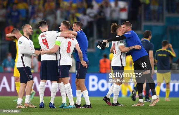Luke Shaw, Declan Rice, Jordan Henderson, Conor Coady, Kalvin Phillips and Sam Johnstone of England celebrate their side's victory after the UEFA...
