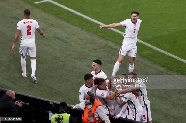 Luke Shaw of England celebrates with Mason Mount, Declan Rice, Kalvin Phillips, Raheem Sterling, Kieran Trippier and Harry Kane after scoring their...