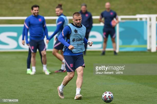 Luke Shaw of England passes the ball during the England Training Session at St George's Park on July 10, 2021 in Burton upon Trent, England.