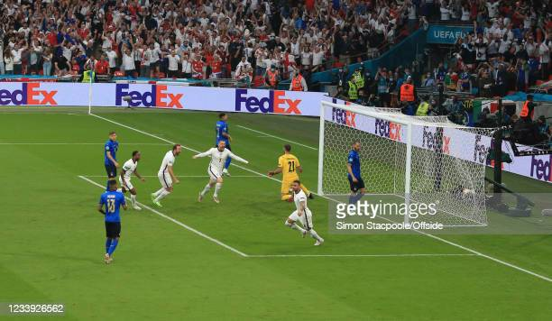 Luke Shaw of England scores the opening goal during the UEFA Euro 2020 Championship Final between Italy and England at Wembley Stadium on July 11,...