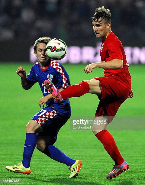 Luke Shaw of England vies with Alen Halilovic of Croatia during the UEFA U21 Championship Playoff Second Leg match between Croatia and England at the...