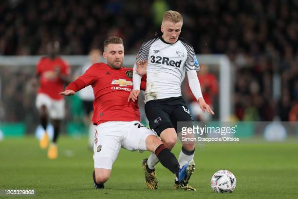 Luke Shaw of Man Utd battles with Louie Sibley of Derby during the FA Cup Fifth Round match between Derby County and Manchester United at Pride Park...