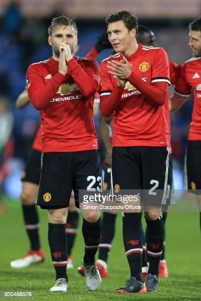 Luke Shaw of Man Utd speaks to teammate Victor Lindelof after The Emirates FA Cup Fifth Round match between Huddersfield Town and Manchester United...