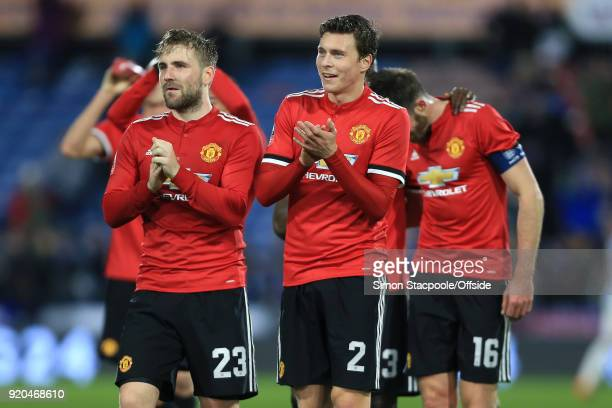Luke Shaw of Man Utd walks off alongside teammate Victor Lindelof at the end of The Emirates FA Cup Fifth Round match between Huddersfield Town and...