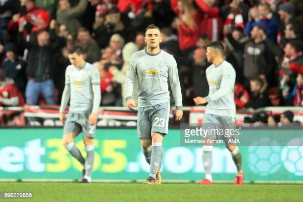 Luke Shaw of Manchester United and his teammates react after Bristol City scored to make it 21 during the Carabao Cup QuarterFinal match between...