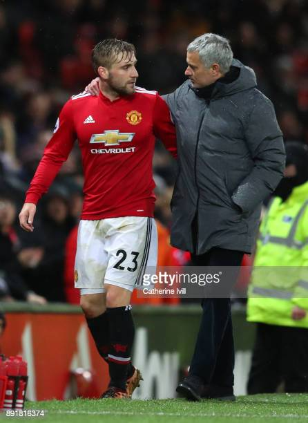 Luke Shaw of Manchester United and Jose Mourinho Manager of Manchester United speak after the Premier League match between Manchester United and AFC...