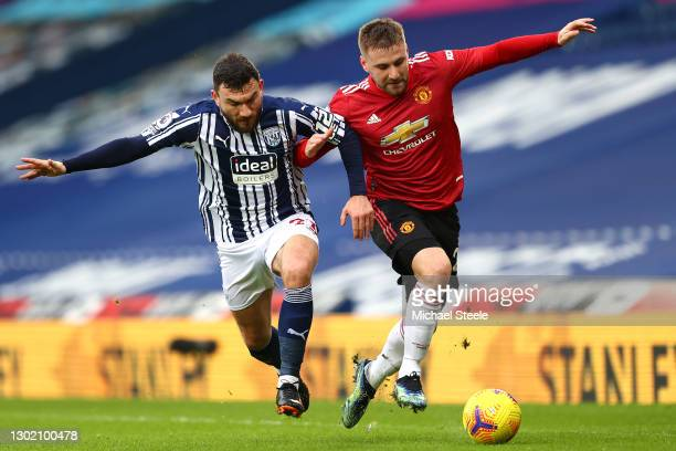 Luke Shaw of Manchester United and Robert Snodgrass of West Bromwich Albion battle for possession during the Premier League match between West...