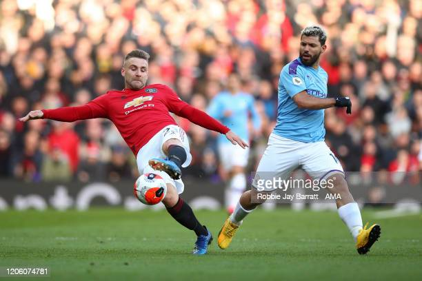 Luke Shaw of Manchester United and Sergio Aguero of Manchester City during the Premier League match between Manchester United and Manchester City at...
