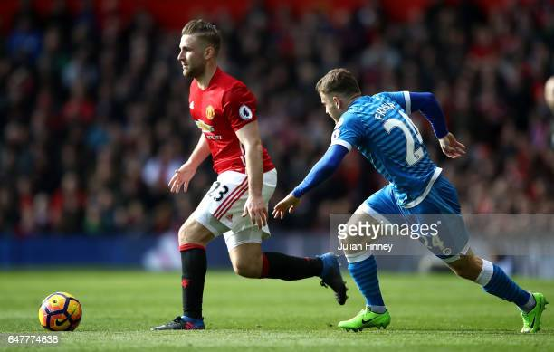 Luke Shaw of Manchester United attempts to take the ball past Ryan Fraser of AFC Bournemouth during the Premier League match between Manchester...