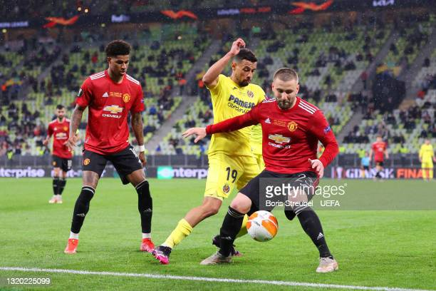 Luke Shaw of Manchester United battles for possession with Francis Coquelin of Villarreal CF during the UEFA Europa League Final between Villarreal...