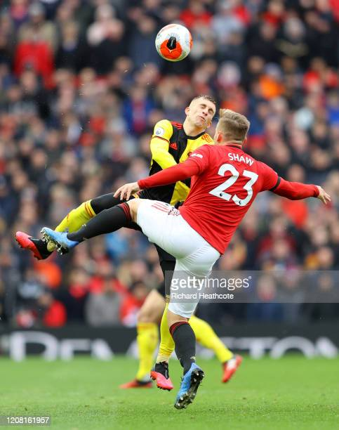 Luke Shaw of Manchester United battles for possession with Gerard Deulofeu of Watford during the Premier League match between Manchester United and...
