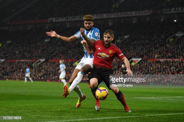 Luke Shaw of Manchester United battles for possession with Philip Billing of Huddersfield Town during the Premier League match between Manchester...