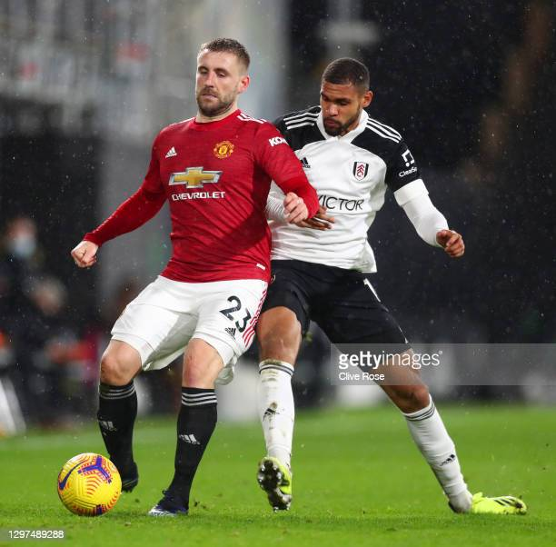 Luke Shaw of Manchester United battles for possession with Ruben Loftus-Cheek of Fulham during the Premier League match between Fulham and Manchester...