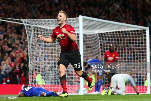 Luke Shaw of Manchester United celebrates scoring a goal to make the score 20 during the Premier League match between Manchester United and Leicester...