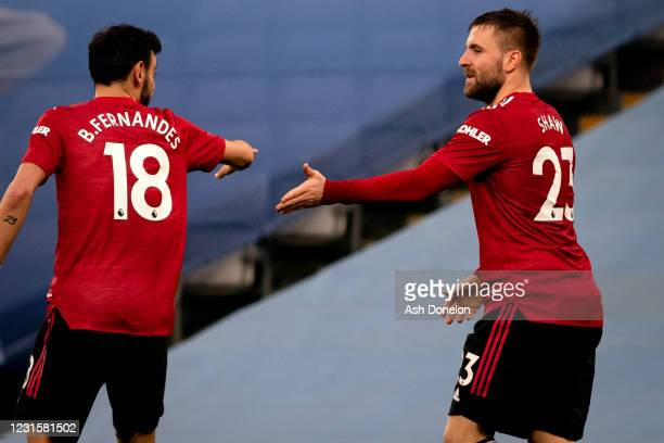 Luke Shaw of Manchester United celebrates scoring a goal to make the score 0-2 with Bruno Fernandes during the Premier League match between...