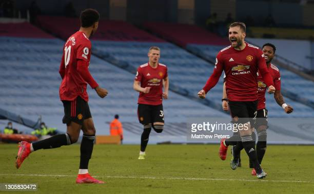 Luke Shaw of Manchester United celebrates scoring their second goal during the Premier League match between Manchester City and Manchester United at...