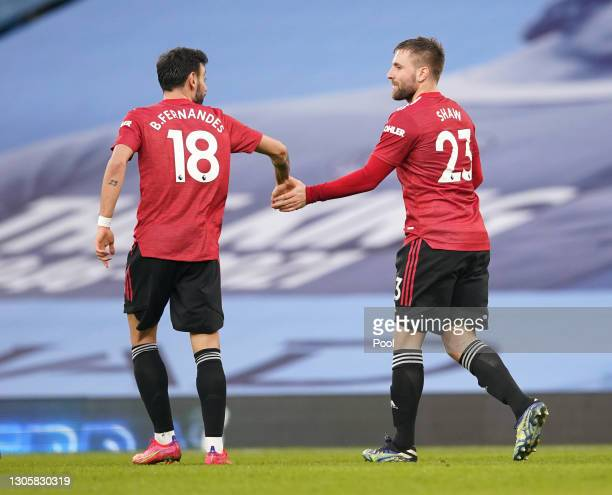 Luke Shaw of Manchester United celebrates with Bruno Fernandes after scoring their side's second goal during the Premier League match between...