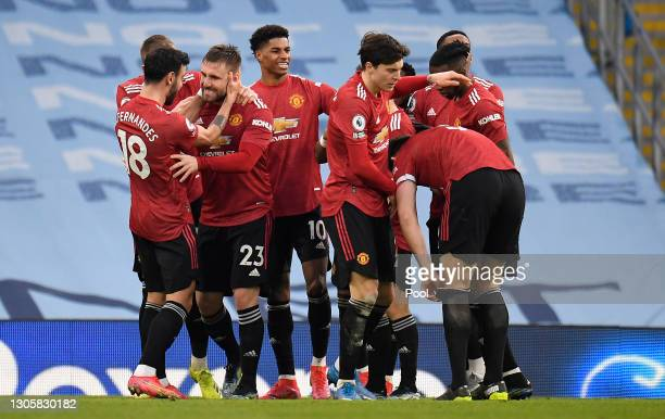 Luke Shaw of Manchester United celebrates with Bruno Fernandes, Marcus Rashford and team mates after scoring their side's second goal during the...