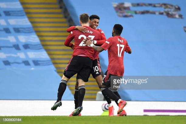 Luke Shaw of Manchester United celebrates with Marcus Rashford and Fred after scoring their side's second goal during the Premier League match...