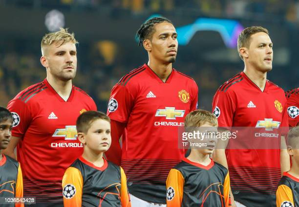 Luke Shaw of Manchester United Chris Smalling of Manchester United Nemanja Matic of Manchester United look on prior to the UEFA Champions League...