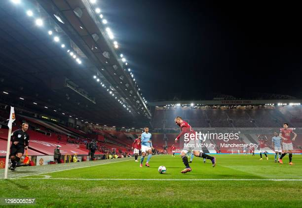 Luke Shaw of Manchester United clears the ball during the Carabao Cup Semi Final match between Manchester United and Manchester City at Old Trafford...