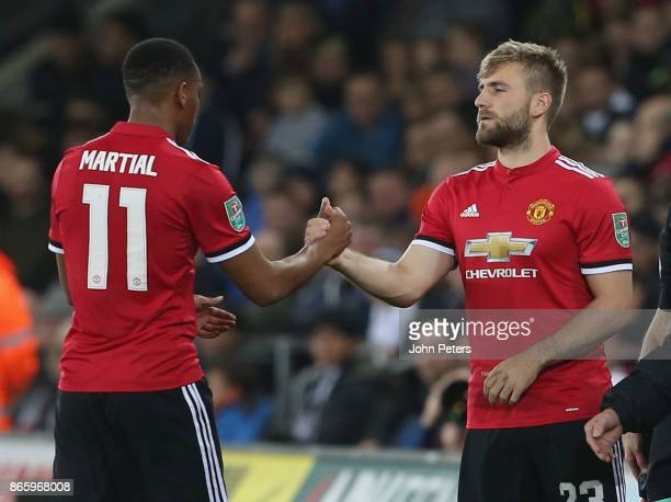 Luke Shaw of Manchester United comes on as a substitute for Anthony Martial during the Carabao Cup Fourth Round match between Swansea City and...