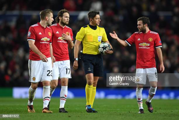 Luke Shaw of Manchester United Daley Blind of Manchester United and Juan Mata of Manchester United appeal to referee Gianluca Rocchi after CSKA...