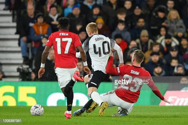 Luke Shaw of Manchester United fouls Louie Sibley of Derby County during the FA Cup match between Derby County and Manchester United at the Pride...