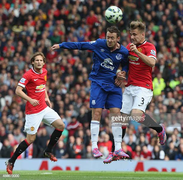 Luke Shaw of Manchester United in action with Aiden McGeady of Everton during the Barclays Premier League match between Manchester United and Everton...