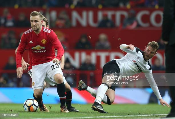 Luke Shaw of Manchester United in action with Andreas Weimann of Derby County during the Emirates FA Cup Third Round match between Manchester United...