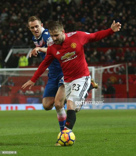 Luke Shaw of Manchester United in action with Darren Fletcher of Stoke City during the Premier League match between Manchester United and Stoke City...