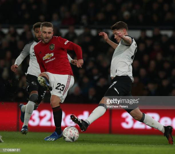 Luke Shaw of Manchester United in action with George Evans of Derby County during the FA Cup Fifth Round match between Derby County and Manchester...