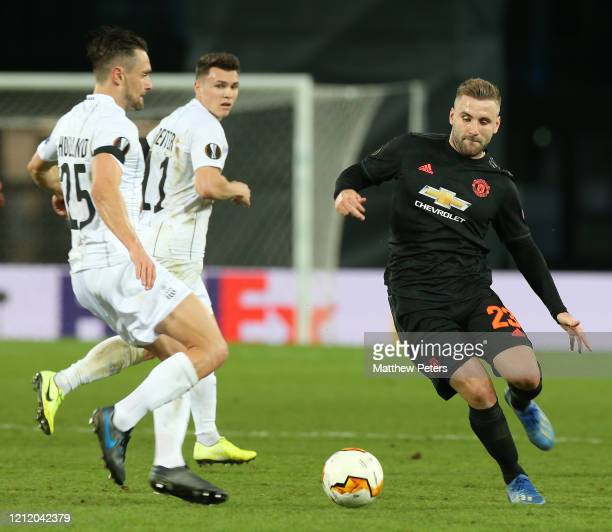 Luke Shaw of Manchester United in action with James Holland of LASK during the UEFA Europa League round of 16 first leg match between LASK and...