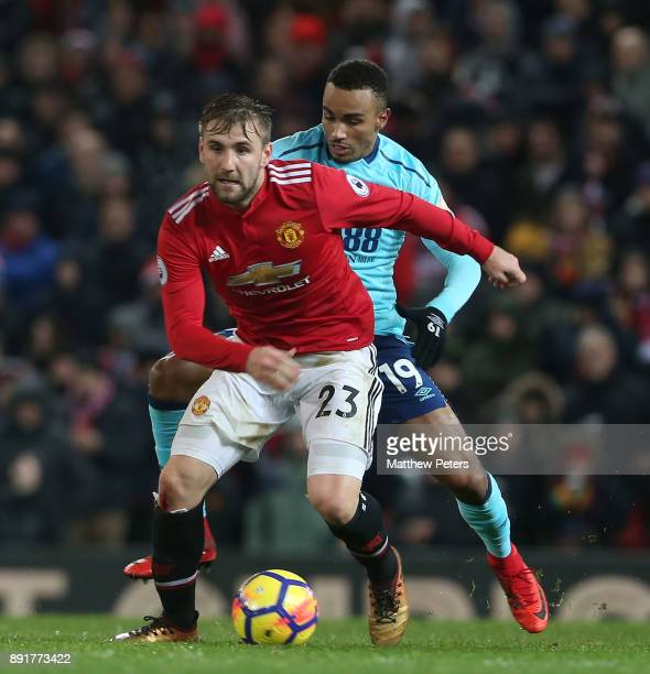 Luke Shaw of Manchester United in action with Junior Stanislas of AFC Bournemouth during the Premier League match between Manchester United and AFC...