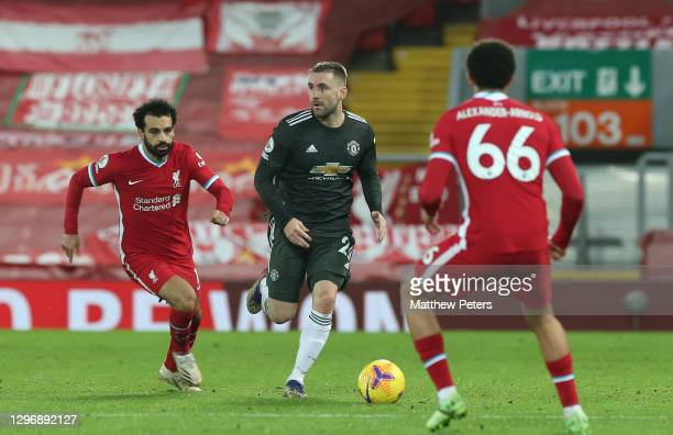 Luke Shaw of Manchester United in action with Mohamed Salah and Trent Alexander-Arnold of Liverpool during the Premier League match between Liverpool...