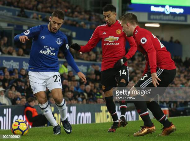 Luke Shaw of Manchester United in action with Nikola Vlasic of Everton during the Premier League match between Everton and Manchester United at...