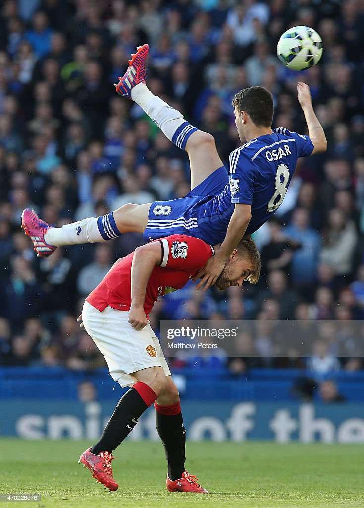 Luke Shaw of Manchester United in action with Oscar of Chelsea during the Barclays Premier League match between Chelsea and Manchester United at Stamford Bridge on April 18, 2015 in London, England.