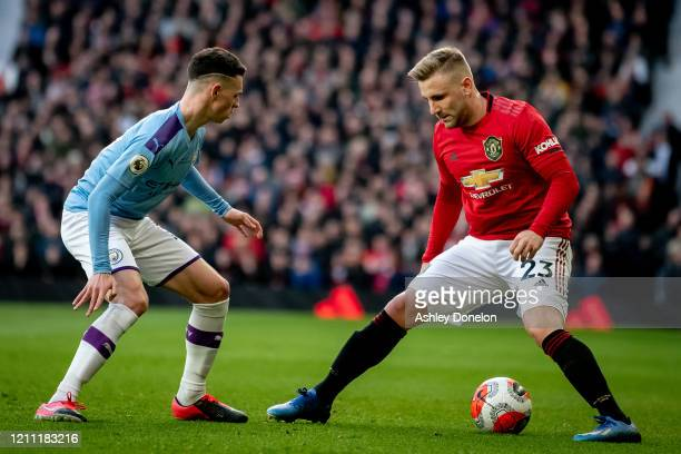 Luke Shaw of Manchester United in action with Phil Foden of Manchester City during the Premier League match between Manchester United and Manchester...